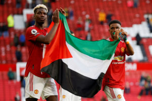 Pogba, Diallo hold up Palestine flag at Manchester United match